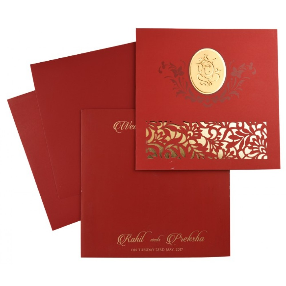 Ganesha theme Hindu wedding card in red with laser cut floral patterns