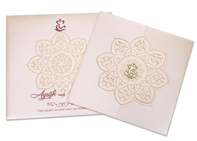 Ganesha theme wedding invitation in cream colour