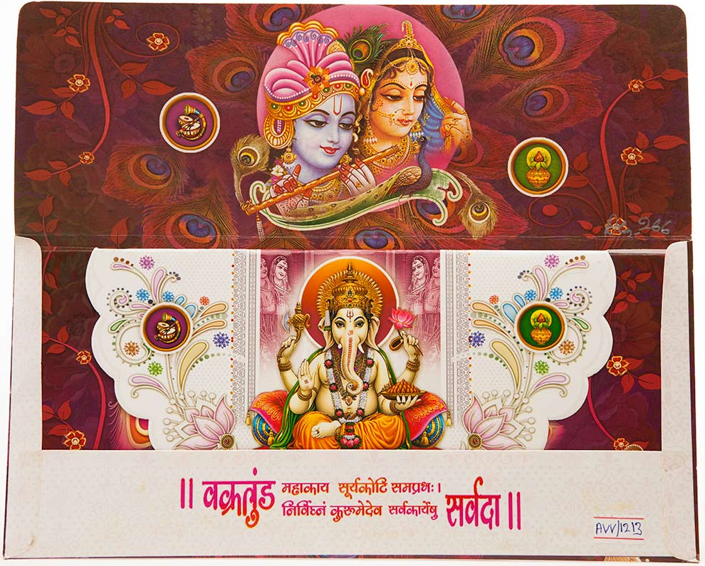 hindu wedding card with radha krishna ganesha peacock motifs