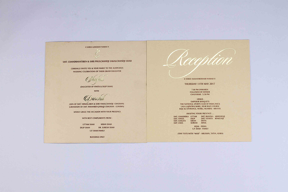 Hindu wedding invitation card in yellow brown colour