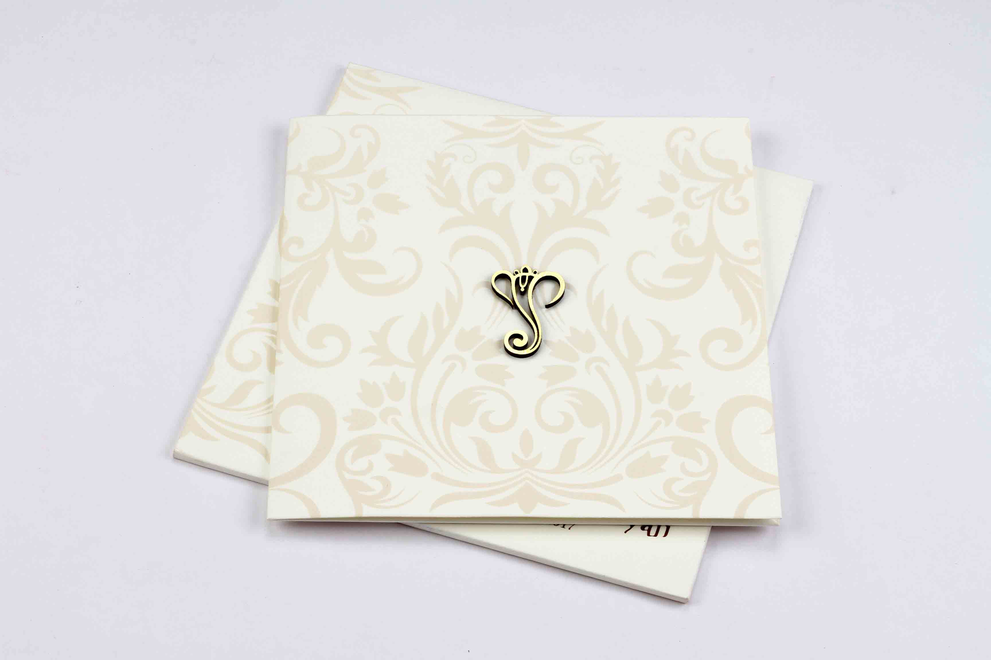 Hindu wedding invitation in off white with floral motifs in peach