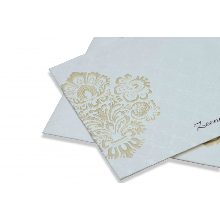 Indian Wedding Card In Ivory With Embossed Motifs Golden