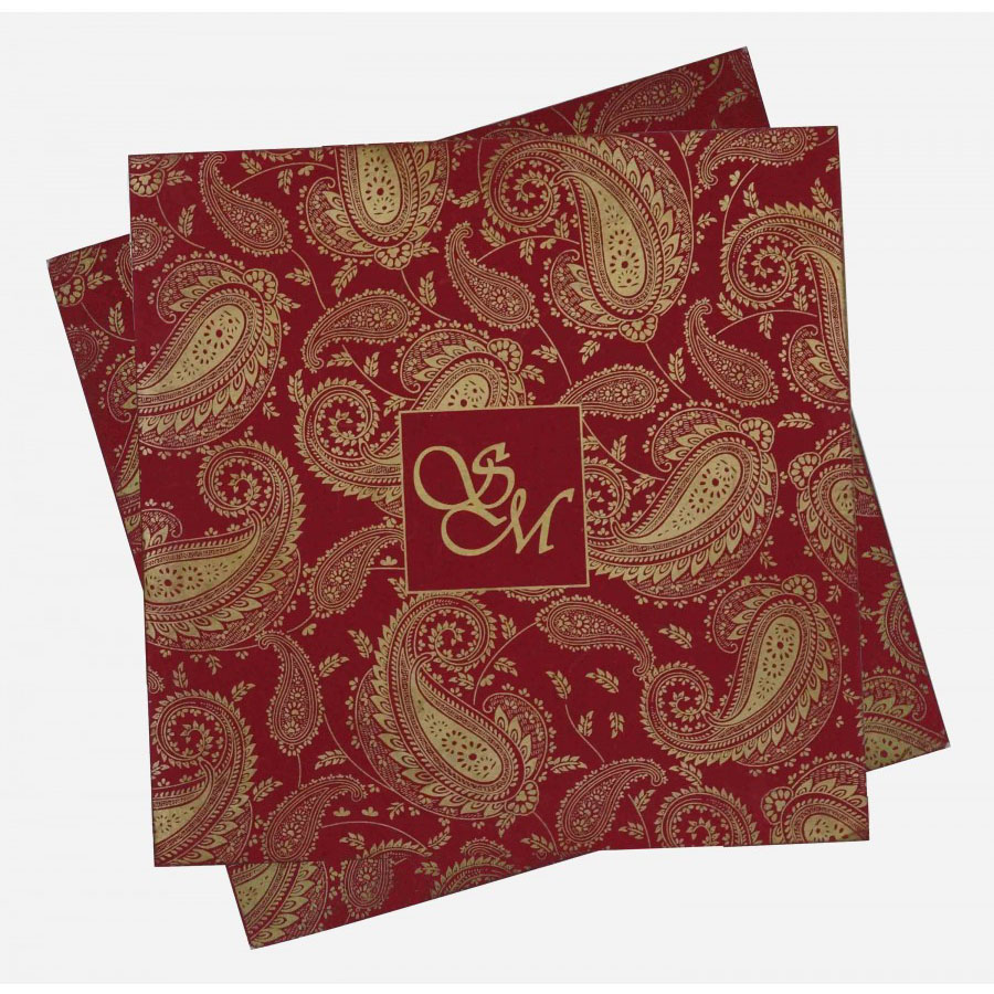 indian wedding card in red with traditional paisley designs