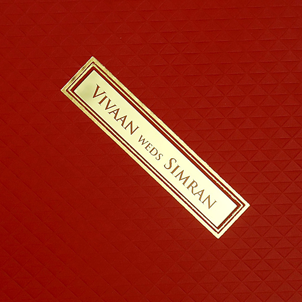 Indian wedding invitation in red with geometric patterns