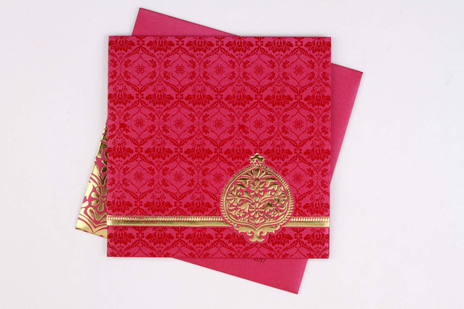 Indian wedding invite in Pink with traditional motif design i