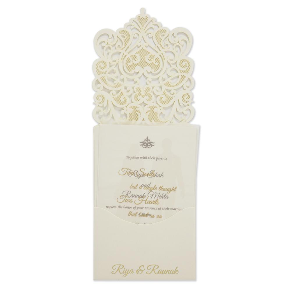 Intricate laser cut design wedding invitation card in cream colour