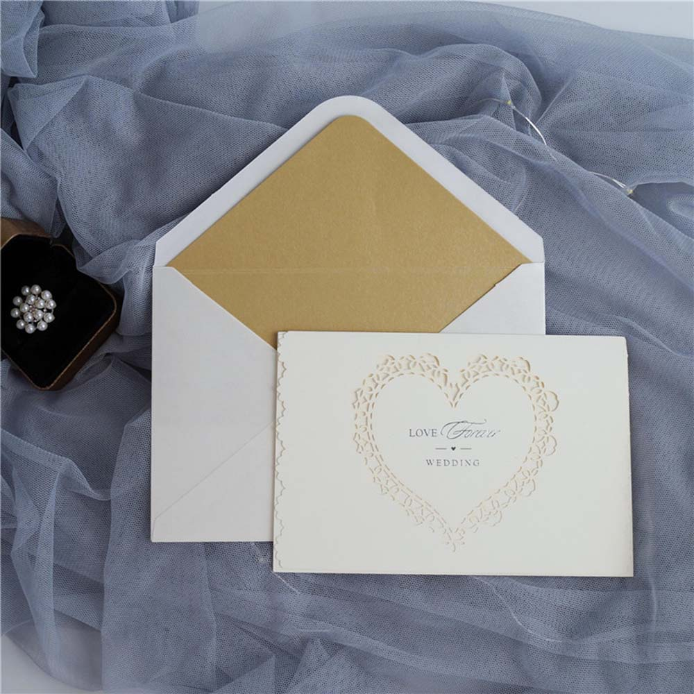 Laser cut wedding invitation in Ivory glitter and a beautiful heart cutout
