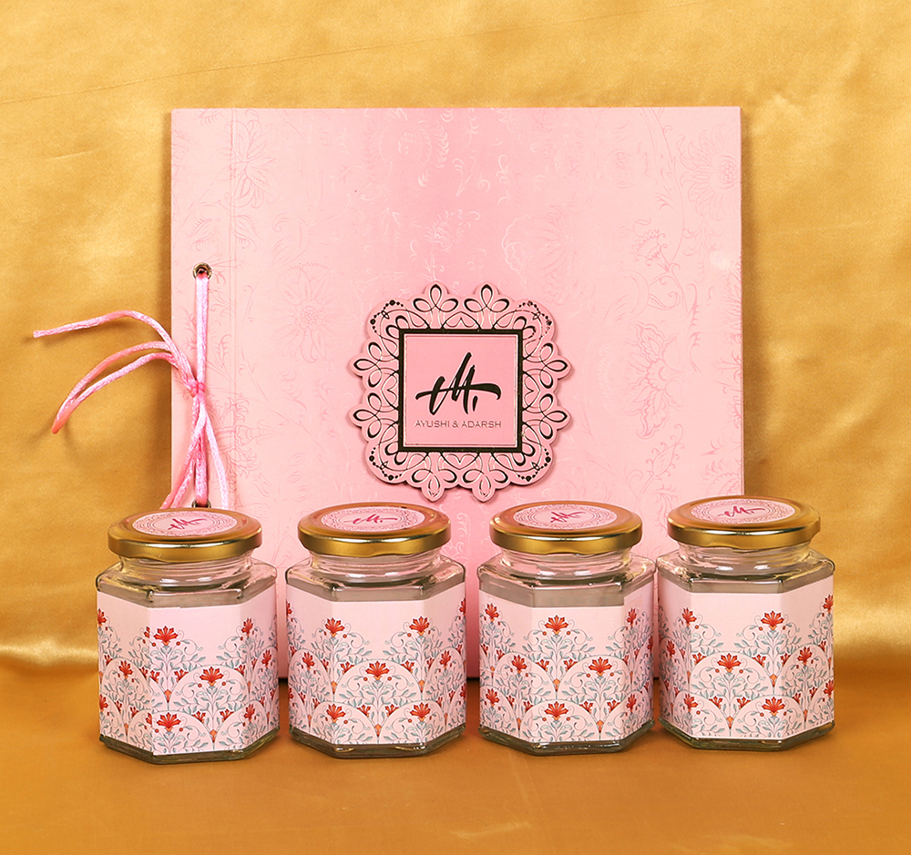 Lotus theme floral wedding boxed invite in pink colour with sweett jars
