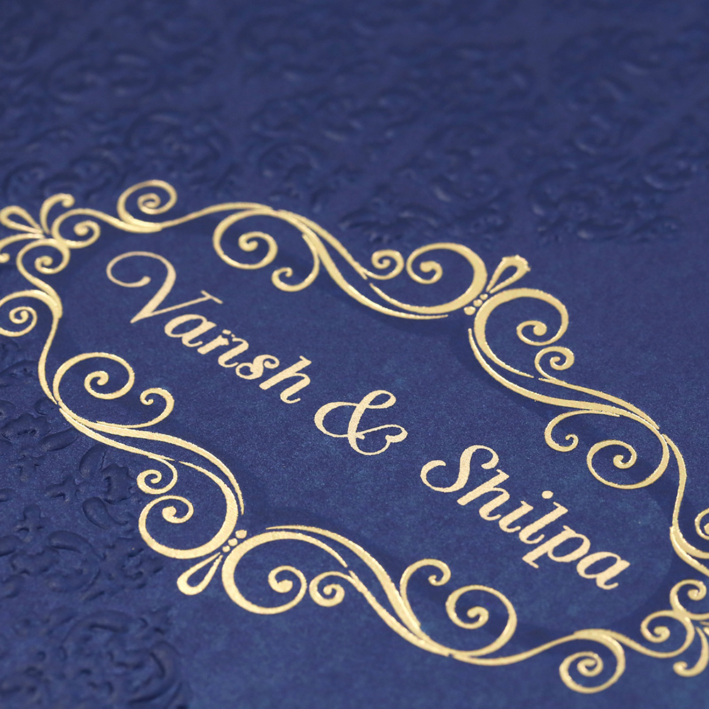 Multfaith Indian Wedding Card In Royal Blue Embossed Floral Motifs