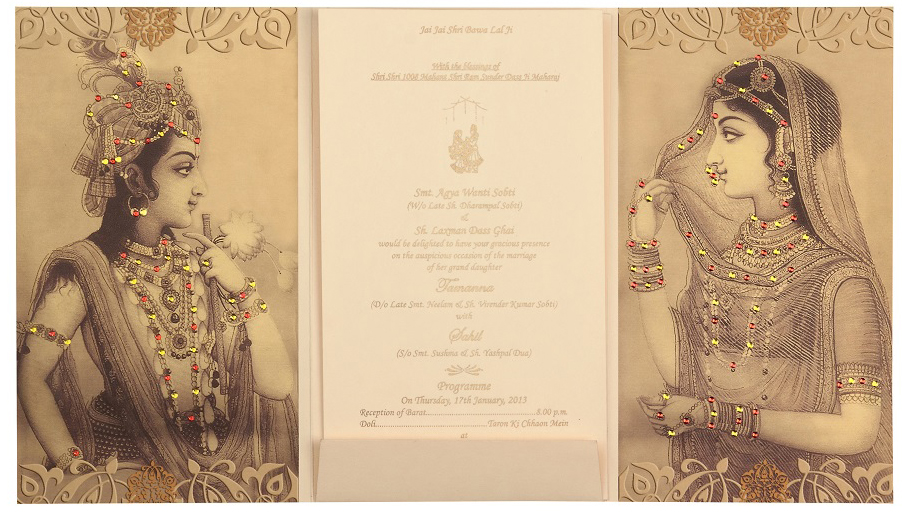 RadhaKrishna Wedding Card in Cream and Golden Colour