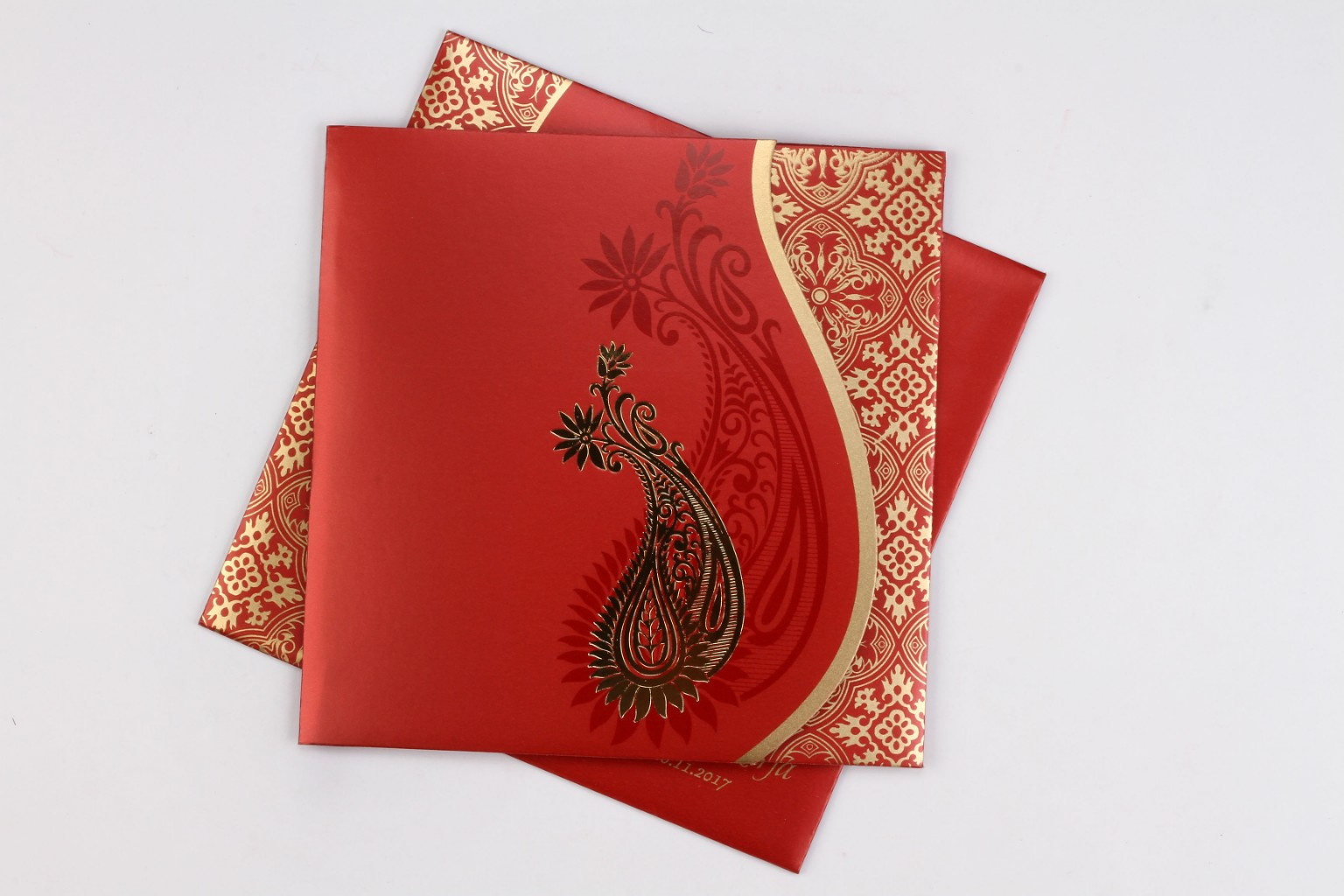 Red wedding invite with golden paisley design