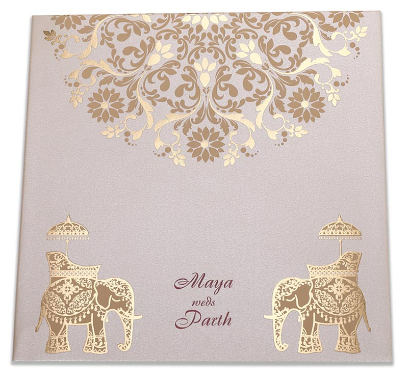 Royal Indian wedding card in cream color with modern design