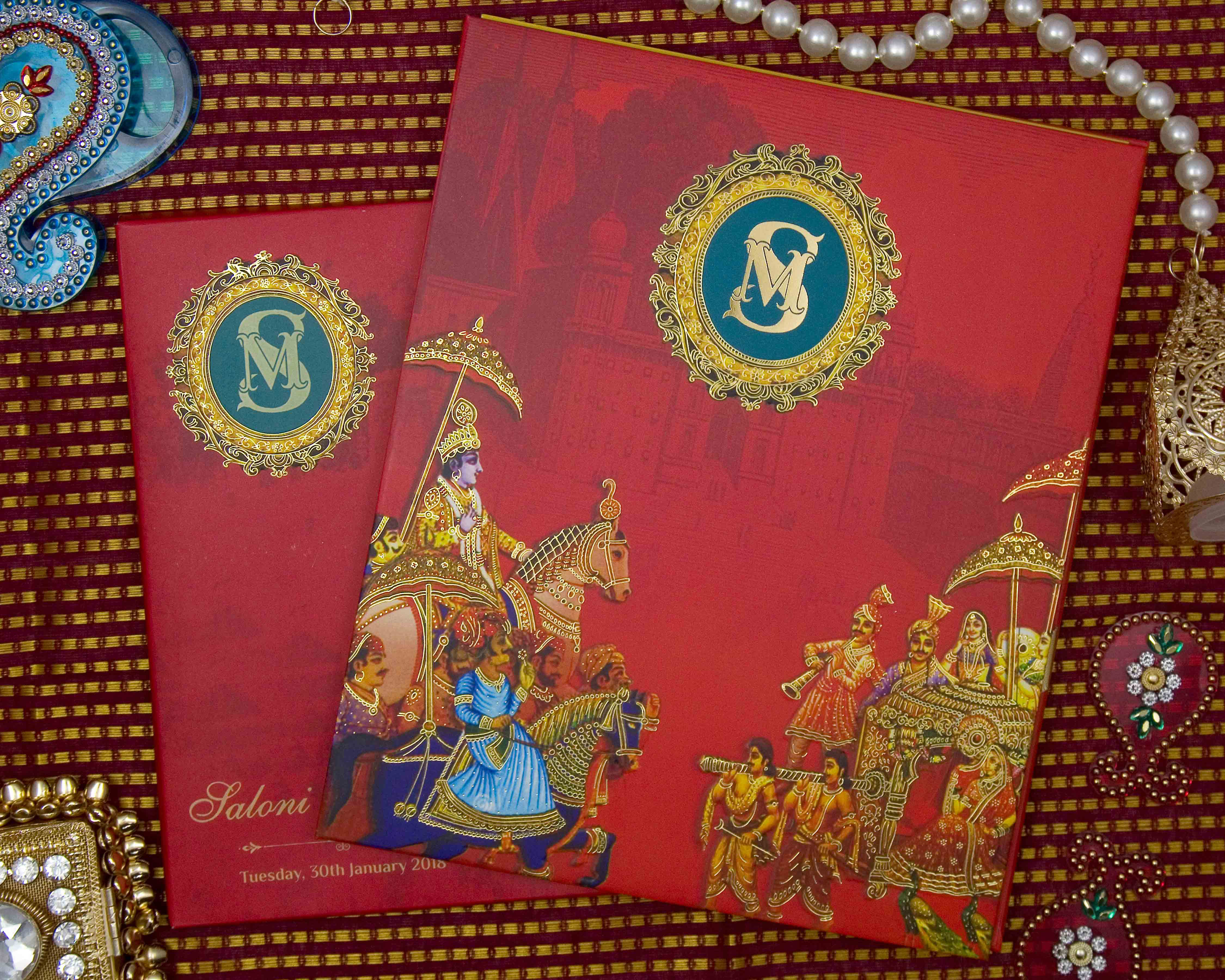 Royal themed Indian wedding invite in red