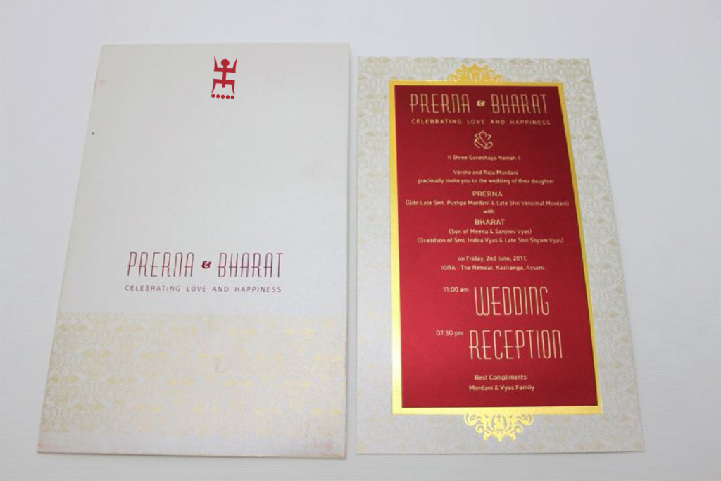 Traditional Bengali wedding invitation in Ivory and Maroon