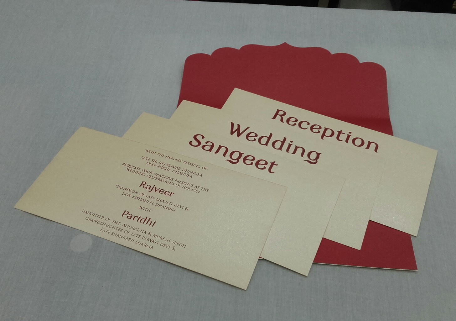 Stylish red and silver wedding invite with laser cut Ganesha design