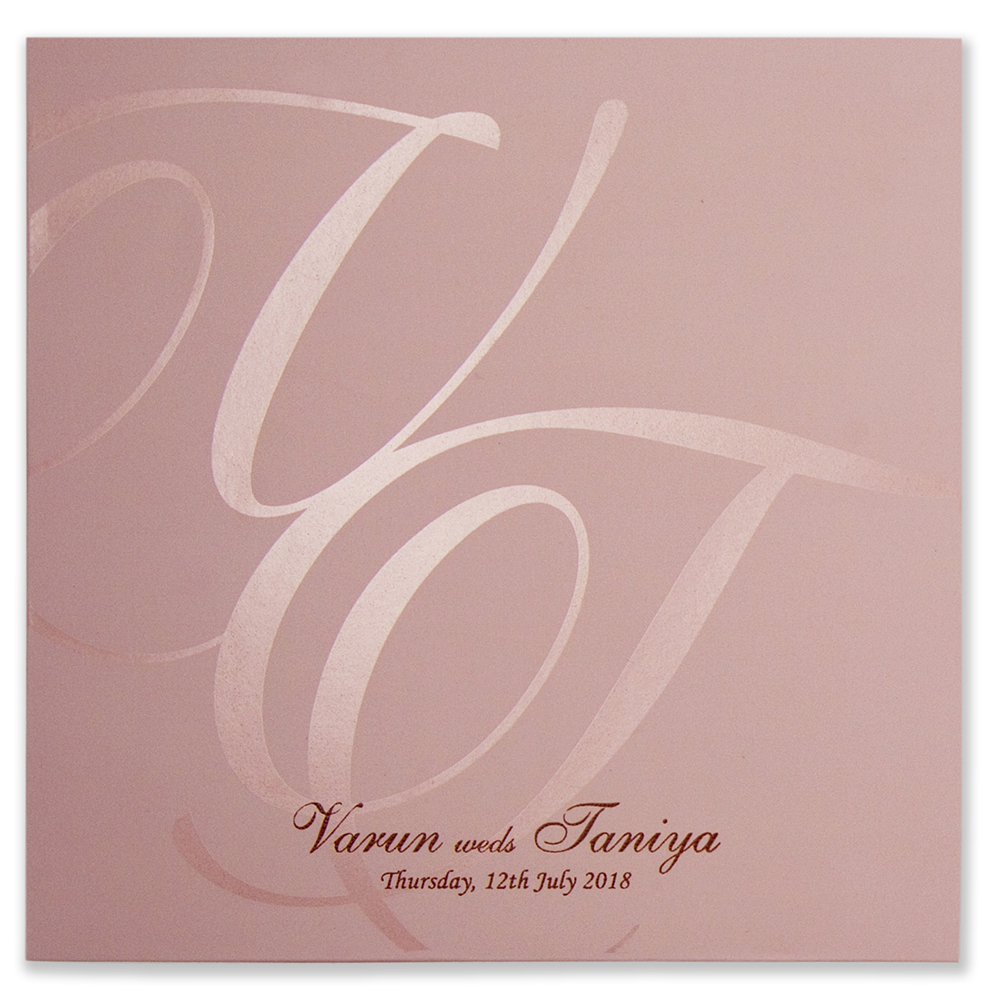 Wedding invitation card in dusty pink with laser cut doves design
