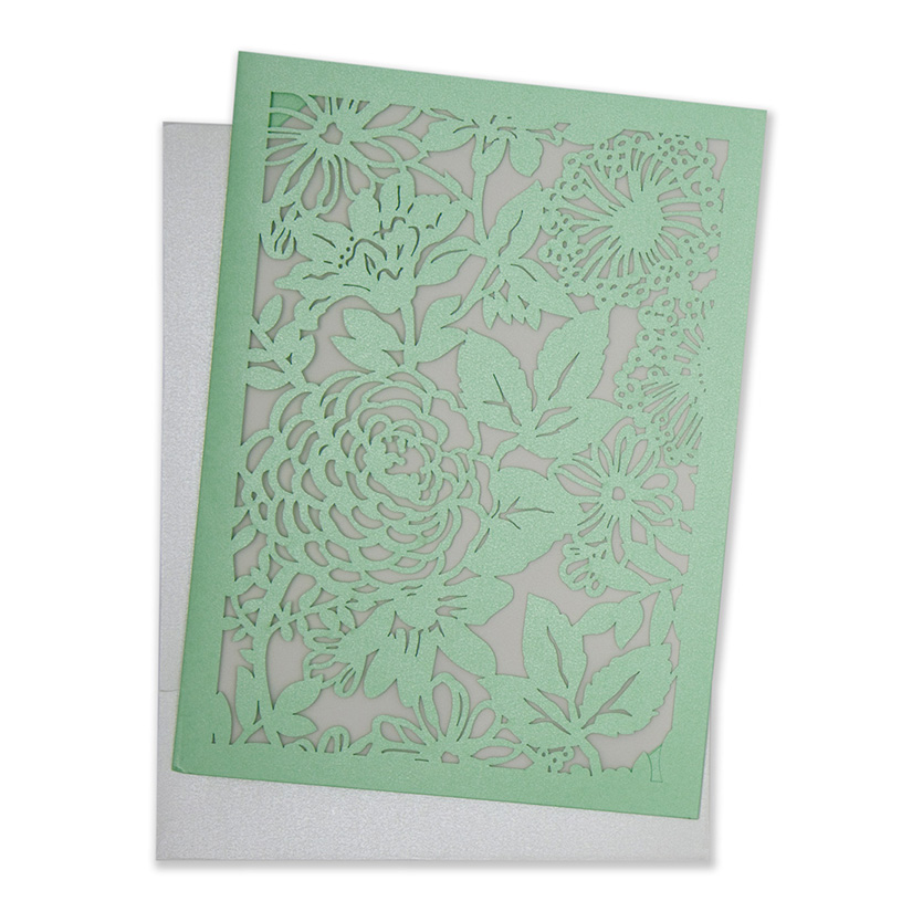 Wedding invitation with laser cut flowers in green colour