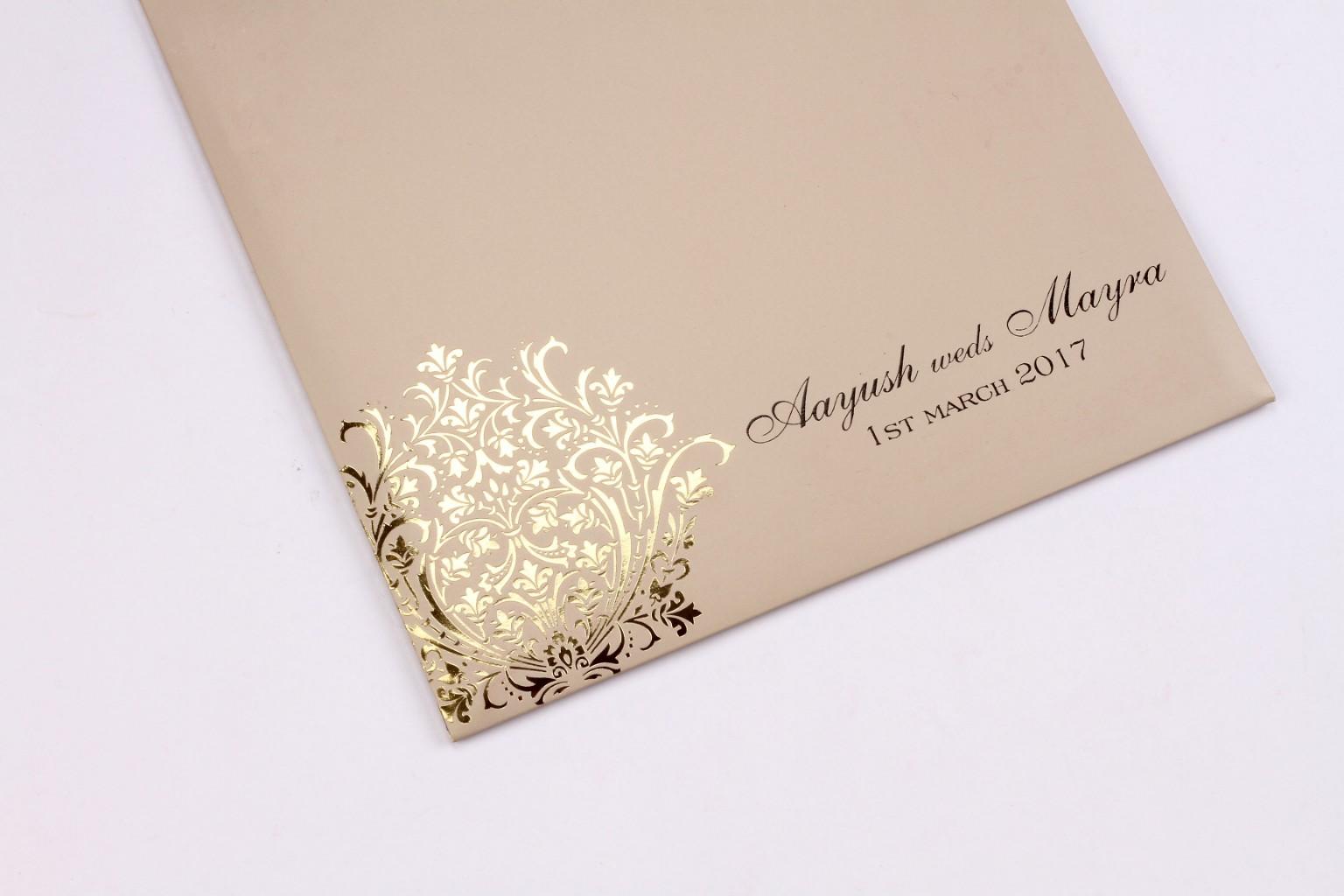 Wedding invite in tan colour with bright golden motif designWedding ...