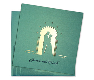 Laser cut invite with wedding couple in turquoise blue