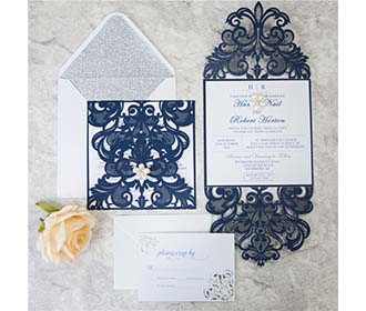 Laser cut wedding inv..