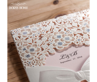 Laser Cut White Floral Wedding Invitation with a bow knot design
