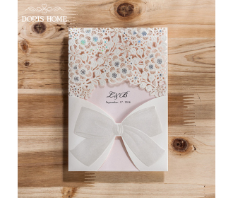Laser Cut White Floral Wedding Invitation with a bow knot design -