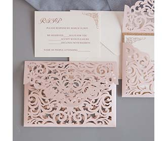 Laser cutt wedding invitation in shimmer blush and rose gold glitter