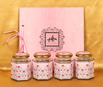 Lotus theme floral wedding boxed invite in pink colour with sweett jars -