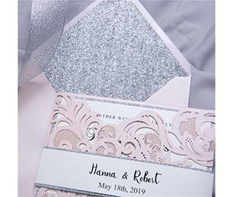 Luxurious laser cut wedding invite in pink and silver glitter