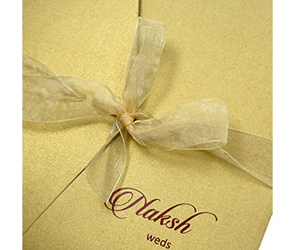 Multifaith indian wedding invite in golden colour wth gatefold