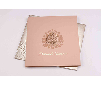 Multifaith wedding invite in baby pink with cut out motifs