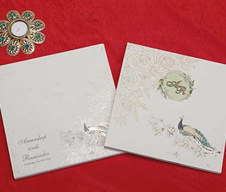 Peacock Design Indian Wedding Card in Ivory Colour