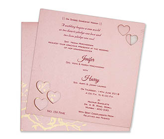 Pink colour wedding invite in cardboard with cut out of hearts