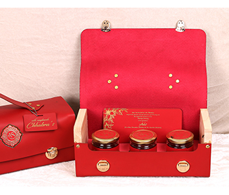 Red color wedding inserts and sweet jars in a bag like box -