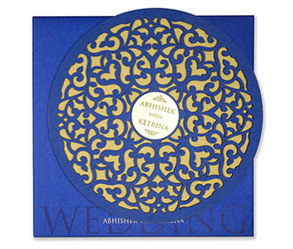 Royal blue cardboard invite with laser cut floral motifs