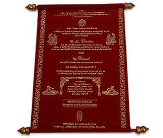Royal scroll wedding invite in maroon with a golden metal case