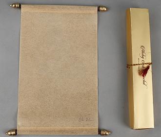 Scroll style wedding card in light orange rectangular box -