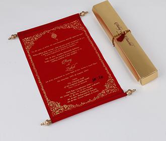 Scroll style wedding invite in red velvet finish with rectangular box