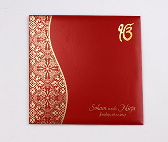 Sikh wedding invite in red with golden paisley