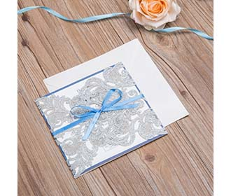 Silver glitter laser cut wedding invite with blue lace