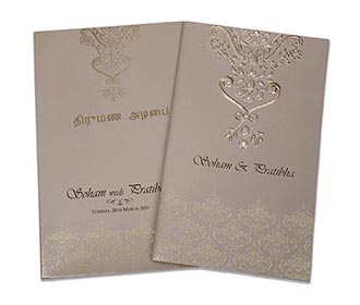 Tamil wedding card in golden beige with golden motifs