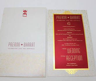Traditional Bengali wedding invitation in Ivory and Maroon -