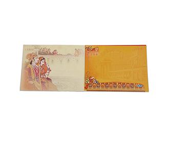 Traditional hindu wedding invitation card in orange colour