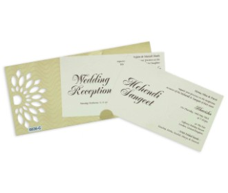 Elegant cream colour wedding invite with cut out motifs