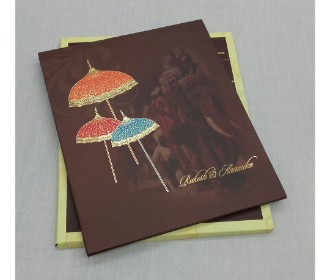 Beautiful brown and golden wedding invite with Umbrellas