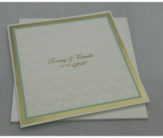 Beautiful cream and golden invite with paisley design