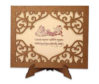 Wedding invitation in laser cut photo frame with designer motifs -