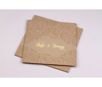 Wedding invite in tan and golden with embossed floral design