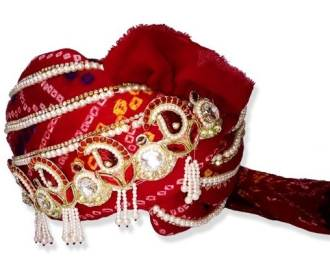 Grooms Turban in Red Bandhej decorated wih motifs and beads -