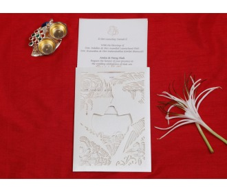 White colored laser cut wedding invite